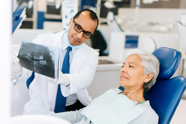 patient looking at x-ray with doctor